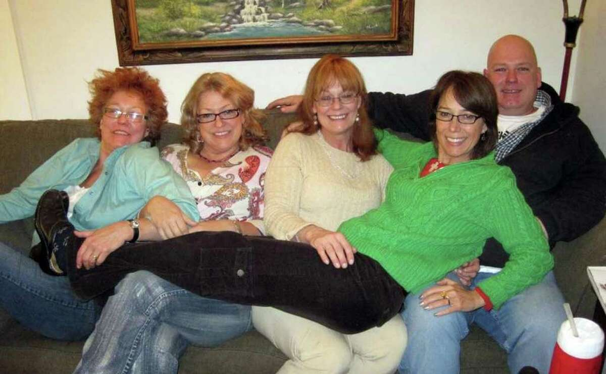 Marianna Mormando with her sisters and brother celebrating Thanksgiving in November 2010.