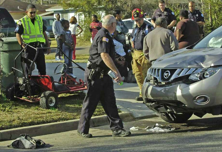 Beaumont Police Officers investigate the scene where two teenagers were involved in a collision with a vehicle while riding a go-cart on the 1700 block of Roberts Avenue. The collision happened at about 2:20 p.m. The teenagers were taken to Christus St. Elizabeth hospital with serious injuries, according to an officer at the scene. Dave Ryan/The Enterprise / Beaumont