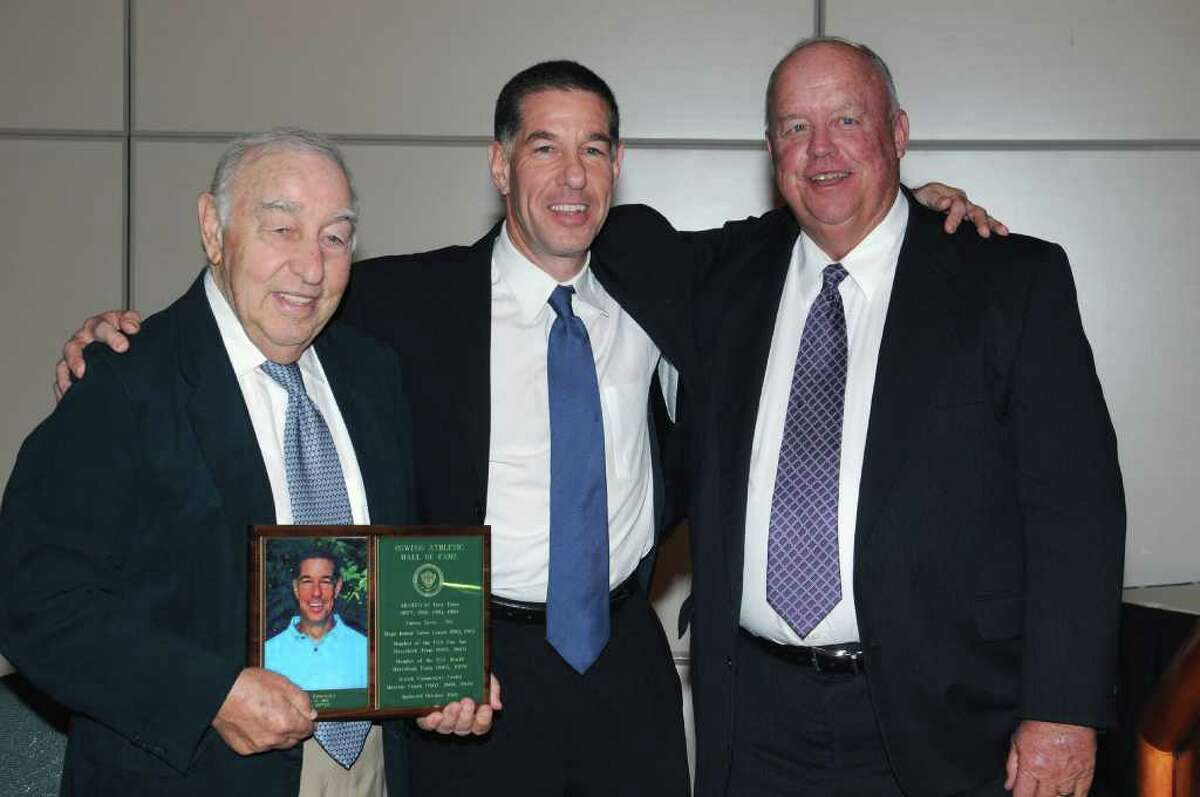Stamford's Rob Zabronsky, center, sports a smile during the SUNY Oswego Hall of Fame induction ceremony in October. Celebrating the moment with the former Lakers goalie is his father Lester, left, and former Oswego coach Ken Peterson.