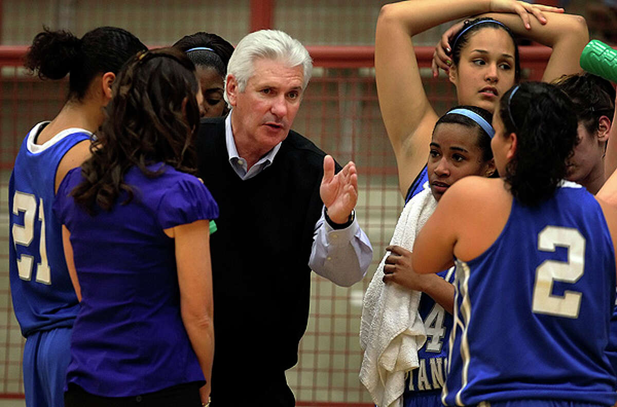 Jay coach Mike Floyd (center) instructs his team during a timeout. Floyd won his 600th game as the Mustangs defeated Brandeis, 66-50, in girls basketball at O'Connor High School on Friday, Jan. 7, 2011.