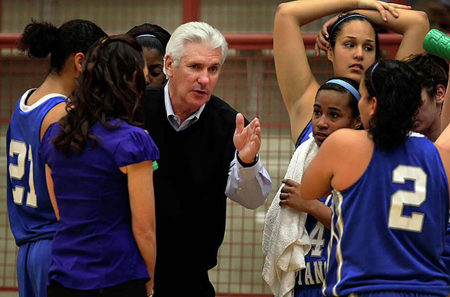 Jay coach Mike Floyd (center) instructs his team during a timeout. Floyd won his 600th game as the Mustangs defeated Brandeis, 66-50, in girls basketball at O'Connor High School on Friday, Jan. 7, 2011. Photo: Kin Man Hui/kmhui@express-news.net