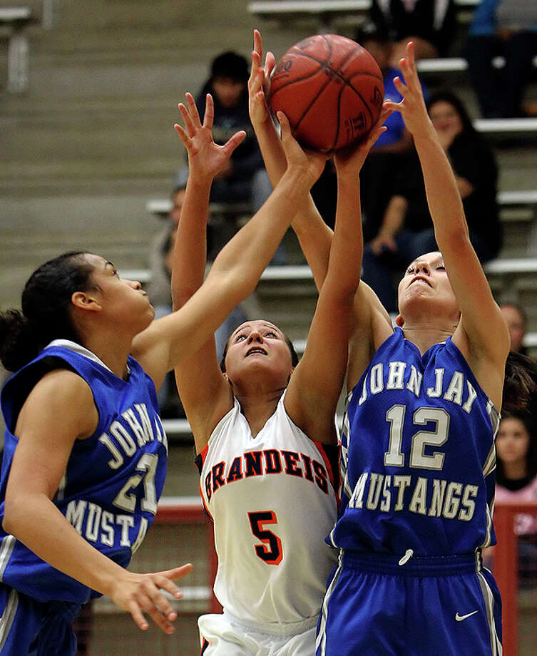 Brandeis' Daisy Womack (05) competes for a rebound with Jay's Erica Donovan (left) and Ashley Mandujano (12) during basketball at O'Connor High School on Friday, Jan. 7, 2011. The Mustangs defeated Brandeis, 66-50, to earn coach Mike Floyd his 600th win as a coach. Photo: Kin Man Hui/kmhui@express-news.net / San Antonio Express-News