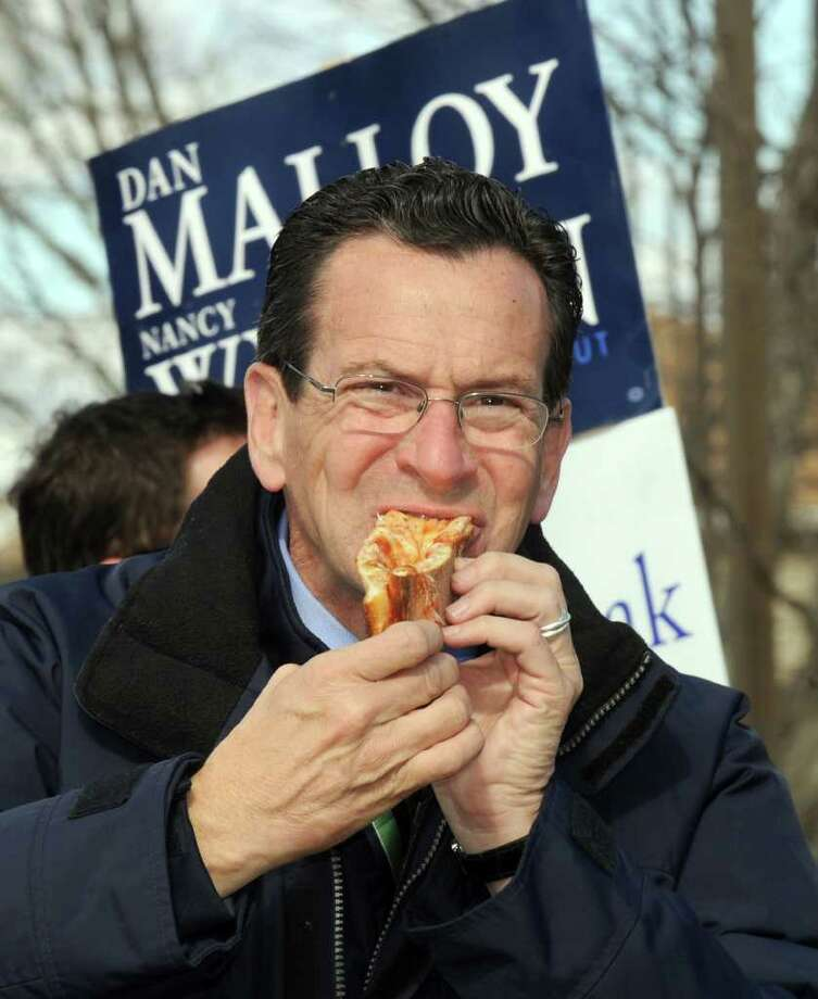 Dan Malloy, the Democratic candidate for governor, grabs a quick lunch of pizza during a stop at Broadview Middle School in Danbury. Photo taken Tuesday, Nov. 2, 2010. Photo: Carol Kaliff, ST / The News-Times