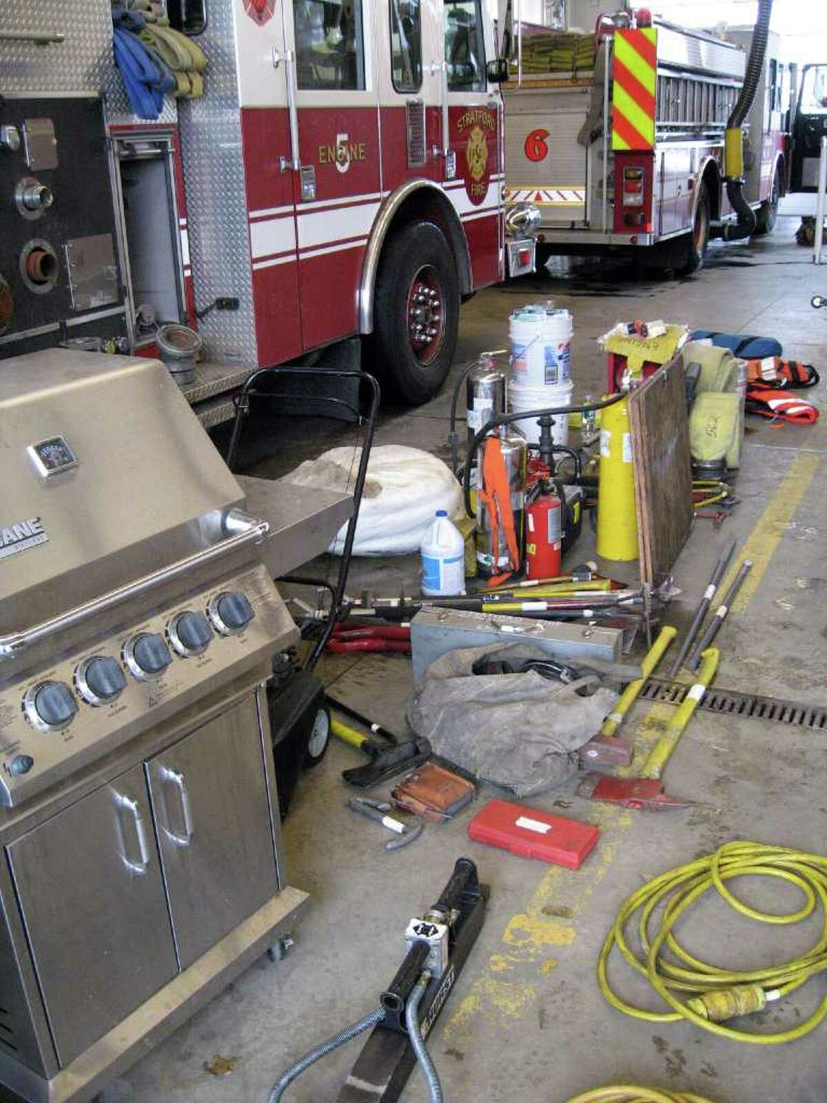 The floor of Stratford Fire Headquarters was covered by the fire-fighting and rescue gear that had been stowed in the two smashed-up fire engines. Both Engine 1, and Engine 5, at left, suffered heavy damage when they were hit by tractor-trailer trucks on I-95 Friday night. Six firefighters also received minor injuries.