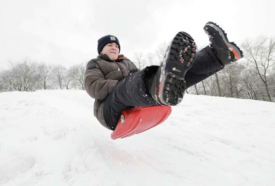 Sean Tobin, 12, of Greenwich, catches some air as he goes over a small jump while sledding in Byram Park, Saturday afternoon, Jan. 8, 2010. Photo: Bob Luckey / Greenwich Time