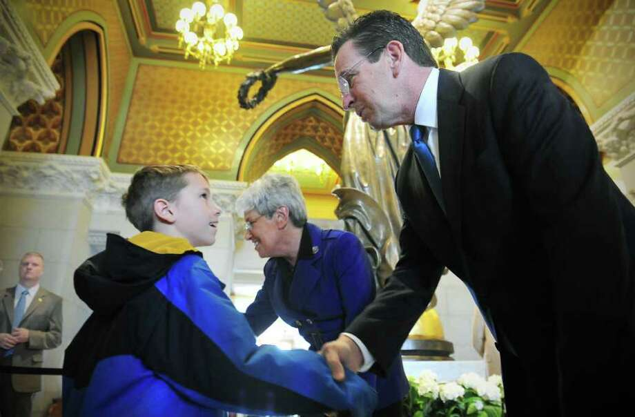 Liam Flynn, 9 of Wethersfield, shakes hands with Governor Dannel P. Malloy during a meet-and-greet with the Governor and Lieutenant Governor Nancy Wyman at the State Capitol in Hartford, Conn. on Saturday January 8, 2011. Photo: Kathleen O'Rourke / Stamford Advocate