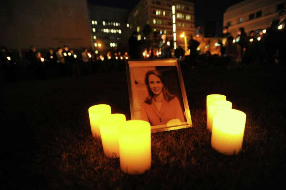 "TUCSON, AZ - JANUARY 8:  People gather for a vigil at University Medical Center for U.S. Rep. Gabrielle Giffords (D-AZ), who was shot during an event in front of a Safeway grocery store January 8, 2011 in Tuscon, Arizona.  U.S. Rep. Gabrielle Giffords (D-AZ) was shot in the head at a public event entitled ""Congress on your Corner"" when a gunman opened fire outside a Safeway grocery store in Tucson, Arizona. It was reported that eighteen people were shot, including members of Giffords' staff, and six are dead, including one young child. One suspect is in custody.  (Photo by Laura Segall/Getty Images) Photo: Laura Segall, Getty Images / 2011 Getty Images"