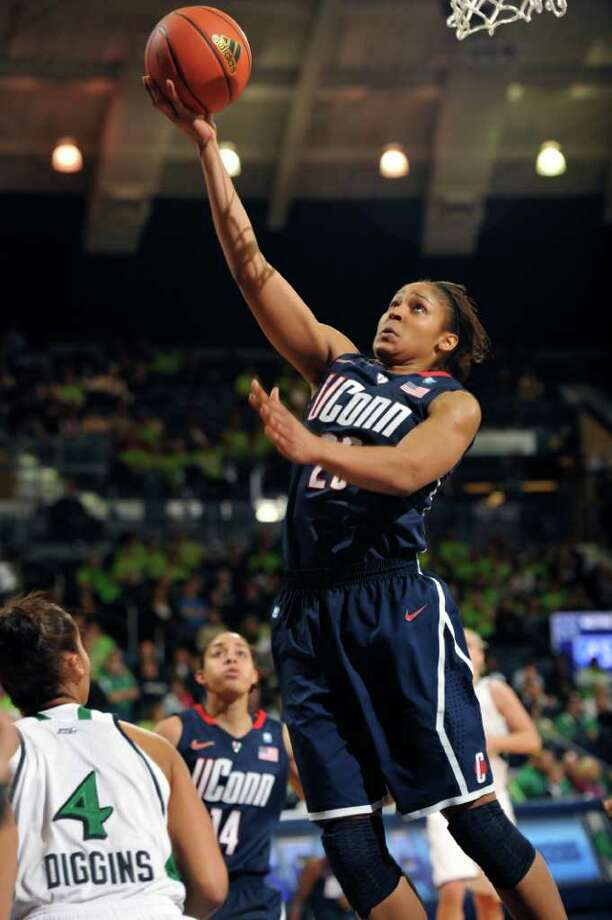 Connecticut guard Maya Moore puts up a shot during second half action in an NCAA college basketball game with Notre Dame Saturday, Jan. 8, 2011 in South Bend, Ind.  (AP Photo/Joe Raymond) Photo: AP