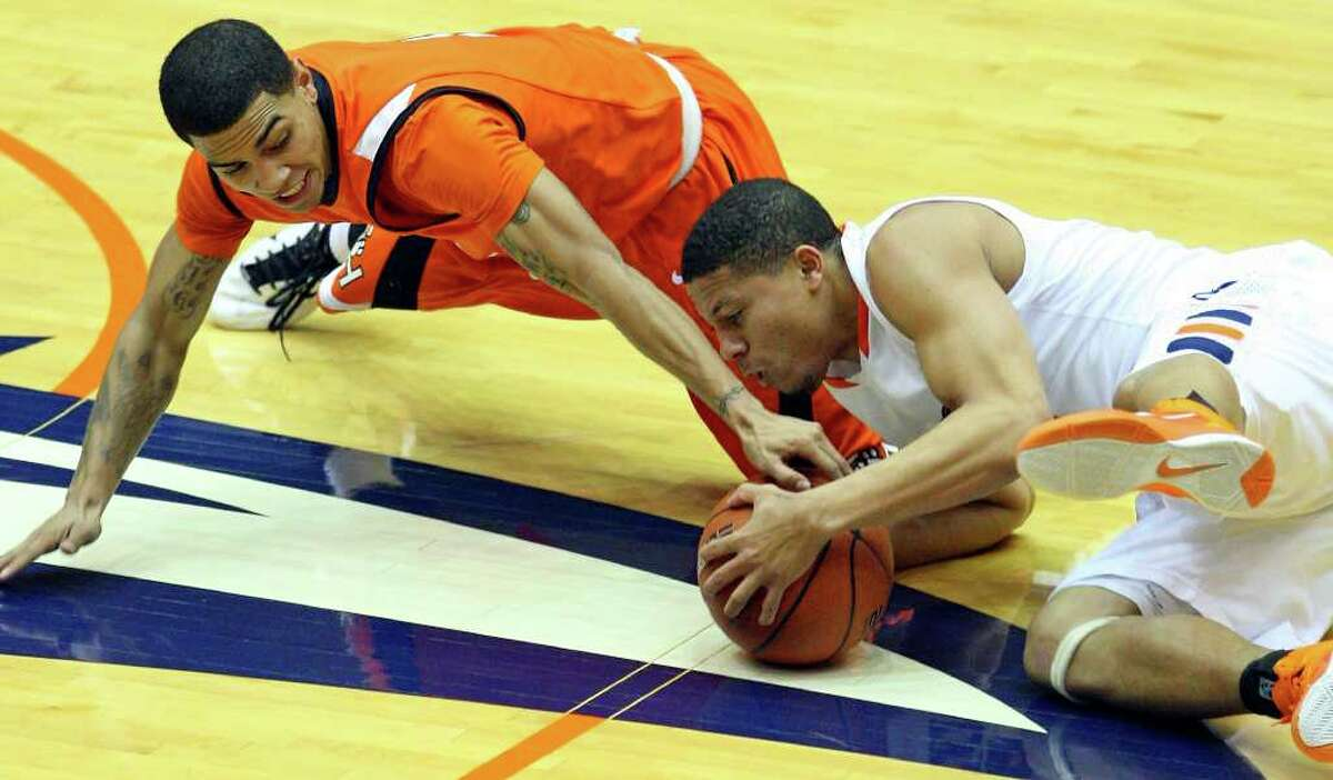 FOR SPORTS - UTSA's Devin Gibson and Sam Houston State's Marcus Williams grab for a loose ball during second half action Saturday Jan. 8, 2011 at the Convocation Center. Sam Houston State won 62-59.
