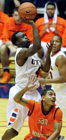 FOR SPORTS - UTSA's Sei Paye shoots over  Sam Houston State's Marcus Willimas during second half action Saturday Jan. 8, 2011 at the Convocation Center.  Sam Houston State won 62-59. Photo: EDWARD A. ORNELAS, SAN ANTONIO EXPRESS-NEWS / eaornelas@express-news.net