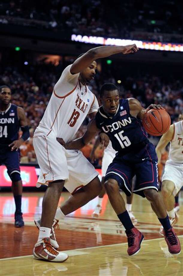 Connecticut guard Kemba Walker pushes off of Texas forward Tristan Thompson during overtime on Saturday in Austin. Connecticut won 82-81 in overtime. Walker was the high scorer with 22 points. Photo: Michael Thomas/Associated Press / AP2011