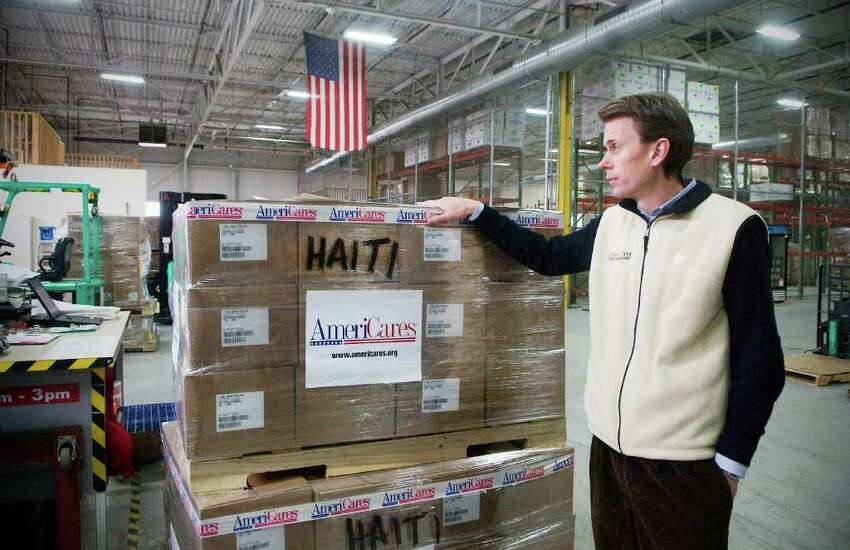 Christoph Gorder, Senior Vice President of Global Program Operations, walks through the AmeriCares warehouse as employees prepare shipments bound for Haiti at their headquarters in Stamford, Conn, on Thursday January 6, 2011.