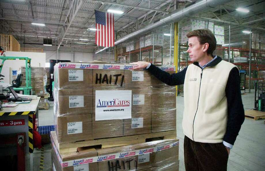 Christoph Gorder, Senior Vice President of Global Program Operations, walks through the AmeriCares warehouse as employees prepare shipments bound for Haiti at their headquarters in Stamford, Conn, on Thursday January 6, 2011. Photo: Kathleen O'Rourke / Stamford Advocate