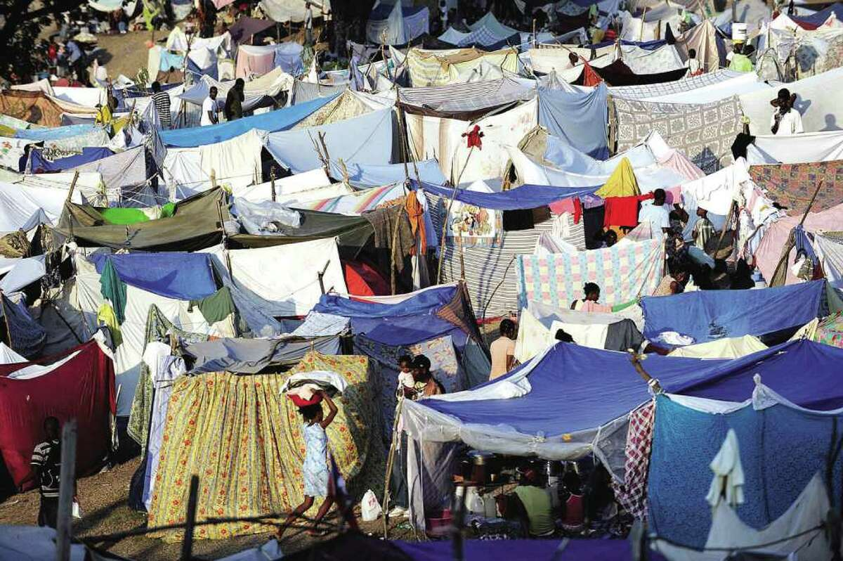 A large tent city has been set up for people displaced by the earthquake at the Petionville Club, at Delma 40B, in Port Au Prince, Haiti, Monday, Jan. 18, 2010. The U.S. Army is distributing food and water at the tent city. (AP Photo/Michael Laughlin, Sun-Sentinel) MANDATORY CREDIT 1/22/10 Citizen photo (contributed) = Destination Haiti. By Anne W. Semmes.