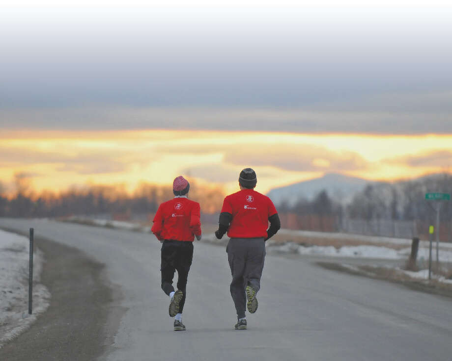 Ralph Sansaricq, right,  and his son Robert, left, run together in Kinderhook one day last month. Robert is autistic, and has recently taken up running, which has helped him to blossom and helps his father accept the challenges of his disability.  ( Philip Kamrass / Times Union ) Photo: Philip Kamrass