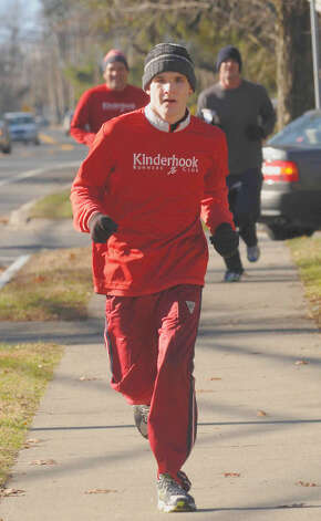 Robert Sansaricq leads his father ,Ralph Sansaricq, and Times Union reporter Bryan Fitzgerald during a 3K training run in Kinderhook in December. Running helped Ralph deal with transition from Haiti to the United States at a young age. One of Ralph?s long-term goals for Robert is to have him run in the New York City Marathon in November.( Michael P. Farrell/Times Union ) Photo: Michael P. Farrell
