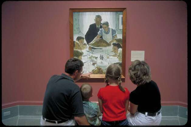 Family observing Rockwell's 'Freedom from Want',  the Norman Rockwell Museum, Stockbridge, MA (Berkshire Visitors Bureau / A. Blake Gardner / Norman Rockwell Museum)