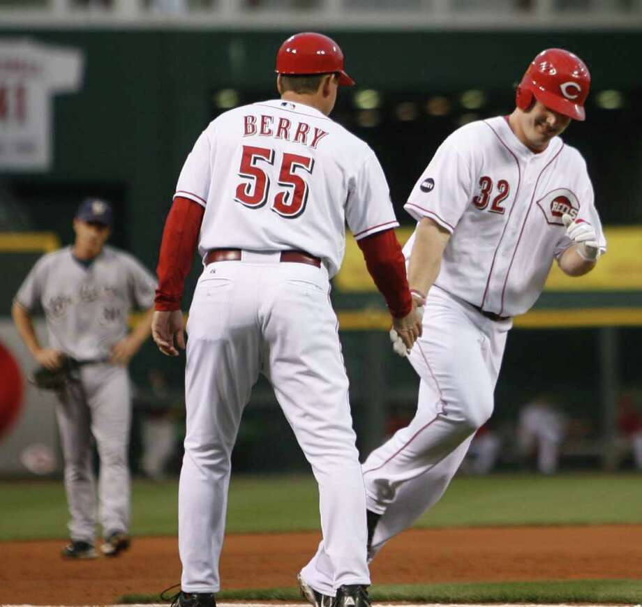Cincinnati Reds' Jay Bruce (32) is congratulated by third base coach Mark Berry (55) after Bruce hit a two-run home run off Milwaukee Brewers pitcher Jeff Suppan in the first inning during a baseball game, Friday, Sept. 19, 2008, in Cincinnati. (AP Photo/David Kohl) Photo: David Kohl / Beaumont