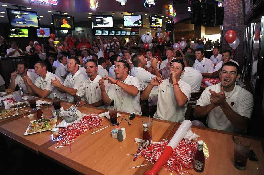 Lamar baseball players celebrate at Major League grill Monday after hearing they will be playing TCU during the first round of NCAA in Fort Worth. Guiseppe Barranco/The Enterprise / Beaumont