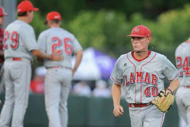 Lamar pitcher Matison Smith, right,  leaves the game after being removed by Coach Jim Gilligan, left, in the fifth inning against TCU during their NCAA tournament game at Lupton Stadium in Fort Worth on Friday, June 4, 2010.  Valentino Mauricio/The Enterprise Photo: Valentino Mauricio / Beaumont