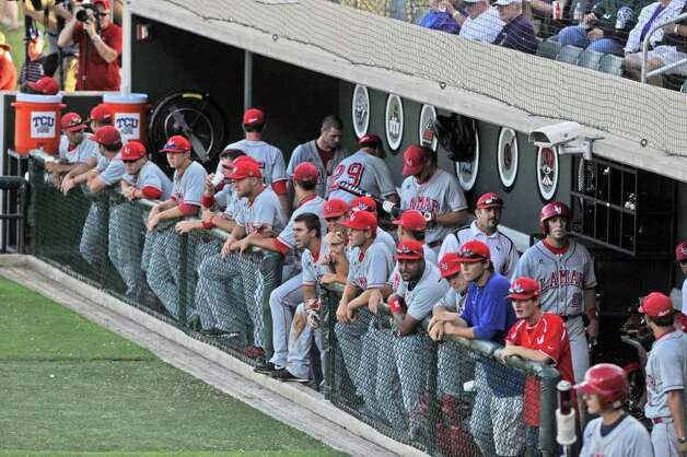 Cardinal players watch the action from the dugout as Lamar takes on TCU in their NCAA tournament game at Lupton Stadium in Fort Worth on Friday, June 4, 2010.  Valentino Mauricio/The Enterprise Photo: Valentino Mauricio / Beaumont