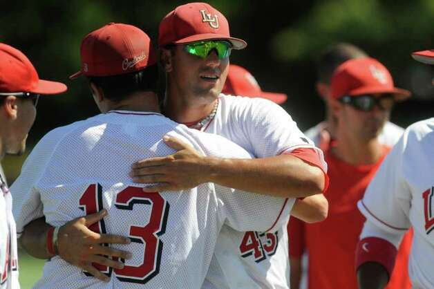 Lamar starting pitcher Jonathan Dziedzic, left, hugs teammate Brandon Chambers after a 6-4 season ending loss to Baylor in their NCAA tournament game at Lupton Stadium in Fort Worth on Saturday,  June 5, 2010.  Valentino Mauricio/The Enterprise Photo: Valentino Mauricio / Beaumont