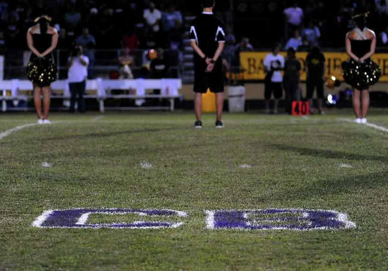 The initials of fallen Newton coach, Curtis Barbay are painted on the field at the Bulldog Stadium i