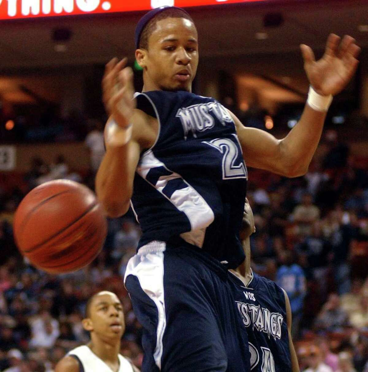 West Orange-Stark's Earl Thomas (No. 22) has the ball knocked out of his hands during a final four playoff basketball game against Carrollton Ranchview at the Frank Erwin Center at the University of Texas in Austin on Thursday, March 9, 2006. Carrollton Ranchview High School won the game 77-52 and advances to the 3A state championship. (PHOTO/THE BEAUMONT ENTERPRISE, Mark M. Hancock)