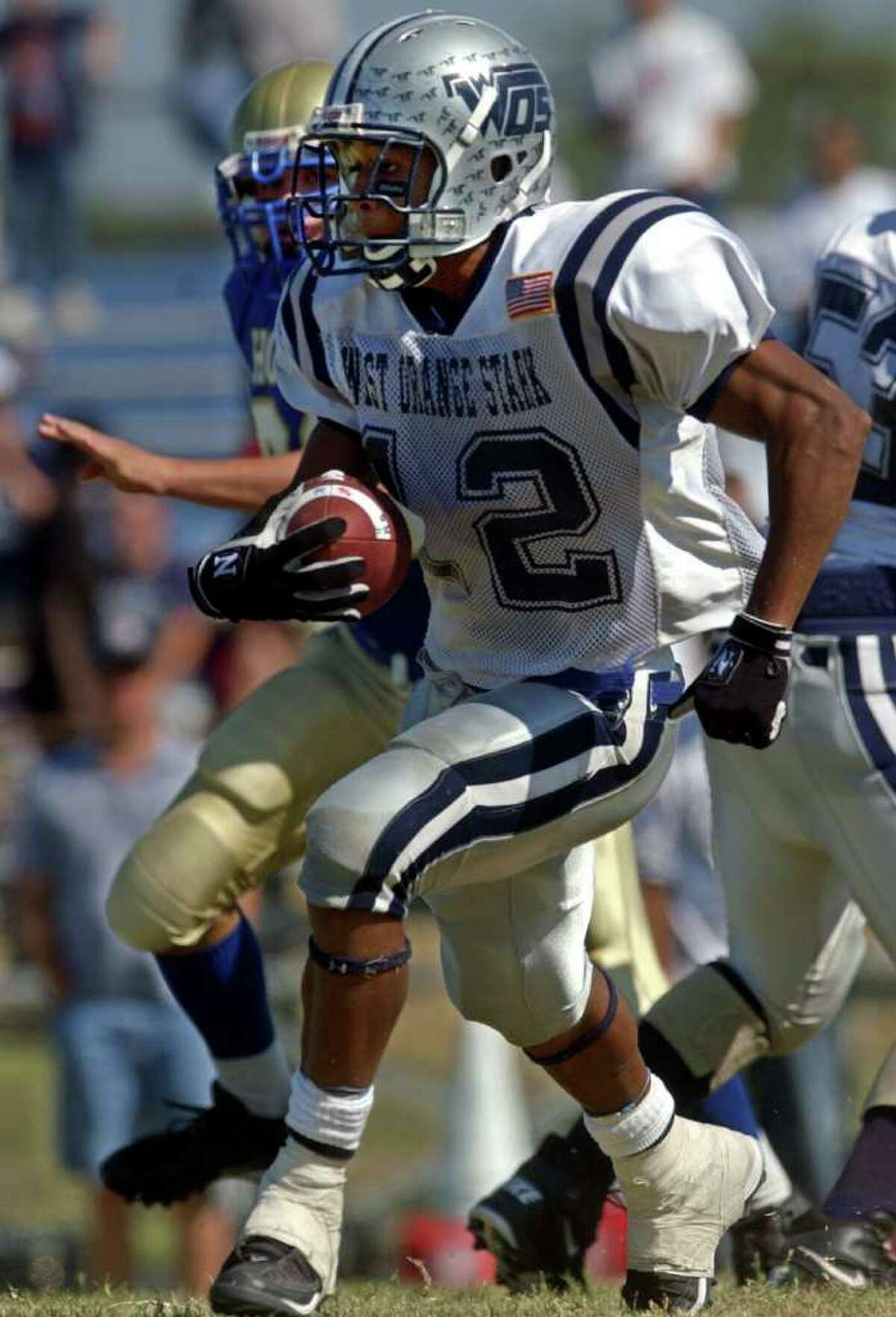 West Orange-Stark's Earl Thomas (No. 12, center) turns a kick into a touchdown against Hamshire Fannett during a football game in Hamshire on Saturday, October 22, 2005. Mark Hancock/The Beaumont Enterprise