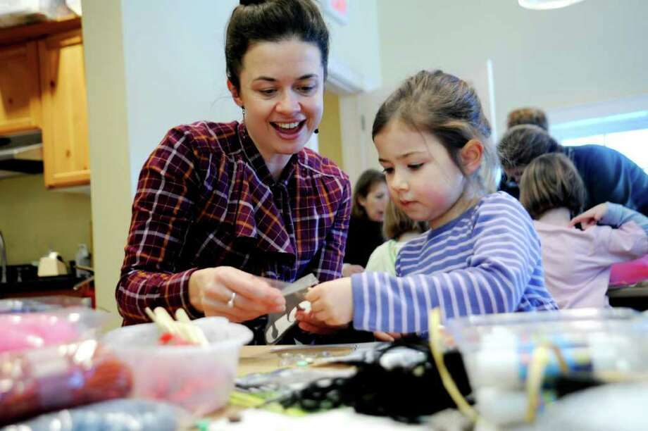 Rebecca Blackshaw helps her daughter Mim Hurley, 5, at the paper doll-making workshop to create wedding attire at the Greenwich Historical Society, in Cos Cob, on Sunday, Jan. 9, 2011. Photo: Helen Neafsey / Greenwich Time