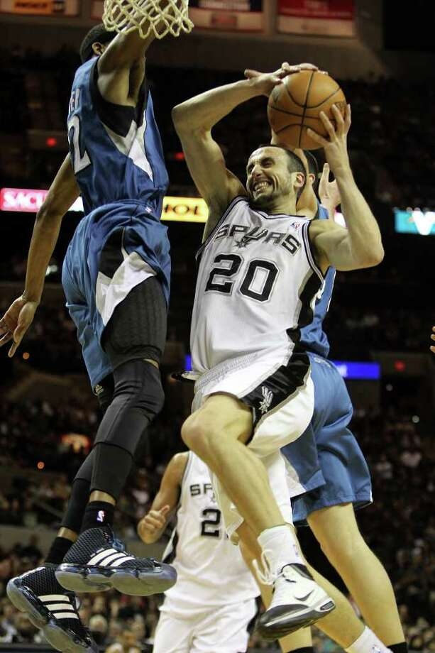 Manu Ginobili shoots in the first half of the Spurs vs. Minnesota Timberwolves matchup at the AT&T Center, Sunday, January 9, 2011. Photo: JENNIFER WHITNEY, Special To The Express-News / special to the Express-News