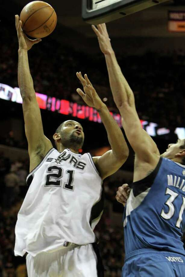 Tim Duncan shoots in the first half of the Spurs vs. Minnesota Timberwolves matchup at the AT&T Center, Sunday, January 9, 2011. Photo: JENNIFER WHITNEY, Special To The Express-News / special to the Express-News