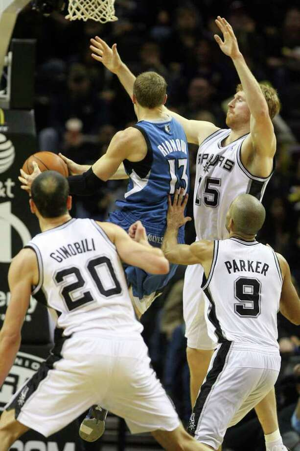 Matt Bonner, Manu Ginobili, and Tony Parker guard Luke Ridnour as he shoots in the second half of the Spurs vs. Minnesota Timberwolves matchup at the AT&T Center, Sunday, January 9, 2011. The Spurs squeezed by 94-91. Photo: JENNIFER WHITNEY, Special To The Express-News / special to the Express-News