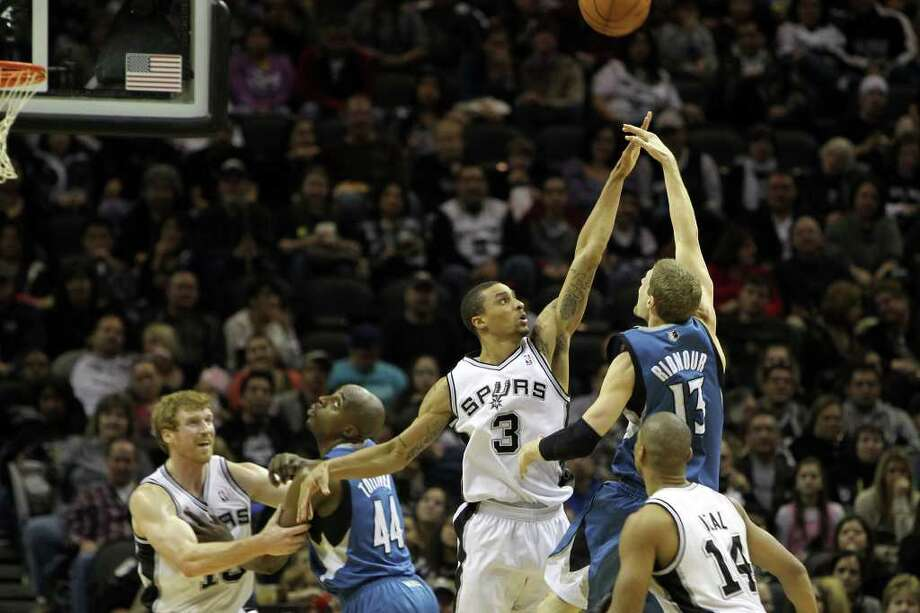 George Hill defends against Luke Ridnour as he shoots in the second half of the Spurs vs. Minnesota Timberwolves matchup at the AT&T Center, Sunday, January 9, 2011. The Spurs squeezed by 94-91. Photo: JENNIFER WHITNEY, Special To The Express-News / special to the Express-News