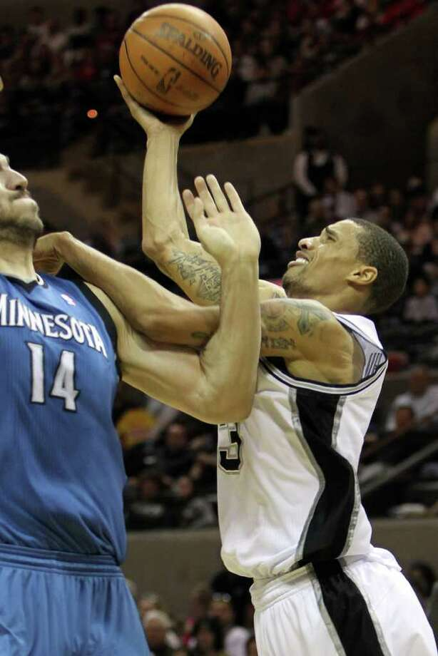 George Hill shoots guarded by Nikola Pekovic in the second half of the Spurs vs. Minnesota Timberwolves matchup at the AT&T Center, Sunday, January 9, 2011. The Spurs squeezed by 94-91. Photo: JENNIFER WHITNEY, Special To The Express-News / special to the Express-News