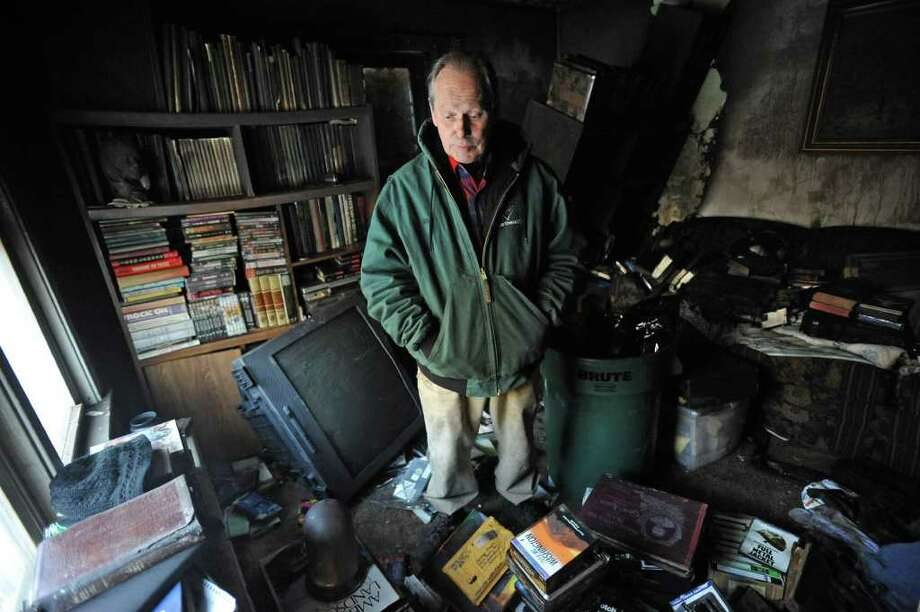 Fred Baye stands inside his burned-out home in East Greenbush, which caught on fire the day after Christmas.  (Lori Van Buren / Times Union) Photo: Lori Van Buren