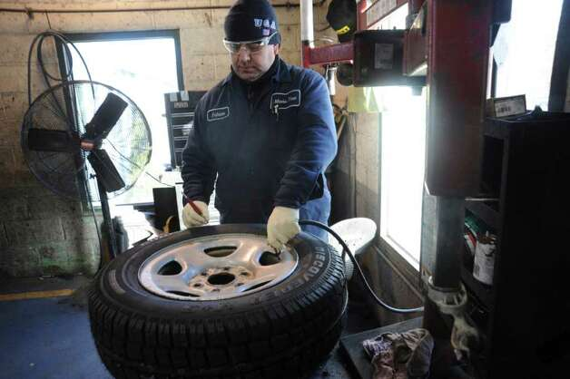 Fabian Guerrero Works On A Snow Tire At Mavis Discount 510842