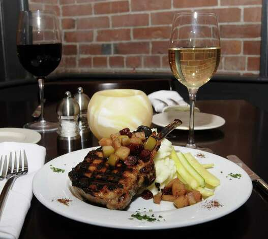 An Order Of Grilled French Cut Berkshire Pork Chop With