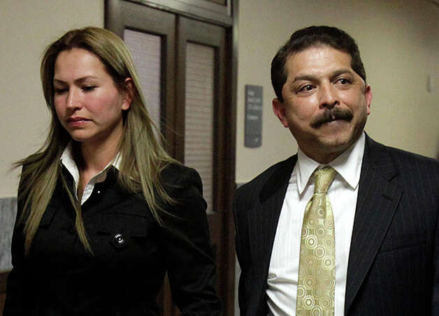 Emilio Navaira walks with his wife Maria Eugenia Navaira after court procedings on Jan. 7.