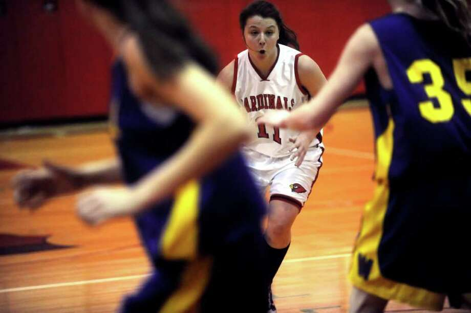 Greenwich High School's #11, Caroline Barrett, drives the ball in the basketball game against Westhill High School, hosted by Greenwich, on Monday, Jan. 10, 2011. Westhill won 51-36. Photo: Helen Neafsey / Greenwich Time