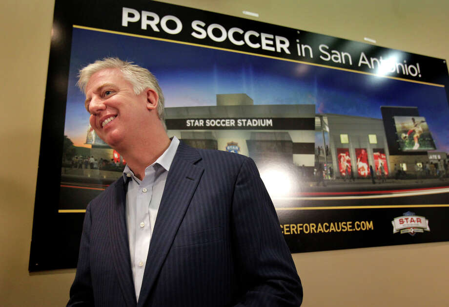 Developer Gordon Hartman announces at a news conference Monday that the new North American Soccer League team coming to San Antonio in 2012 will be named Scorpions FC. Photo: BOB OWEN, SAN ANTONIO EXPRESS-NEWS / SAN ANTONIO EXPRESS-NEWS