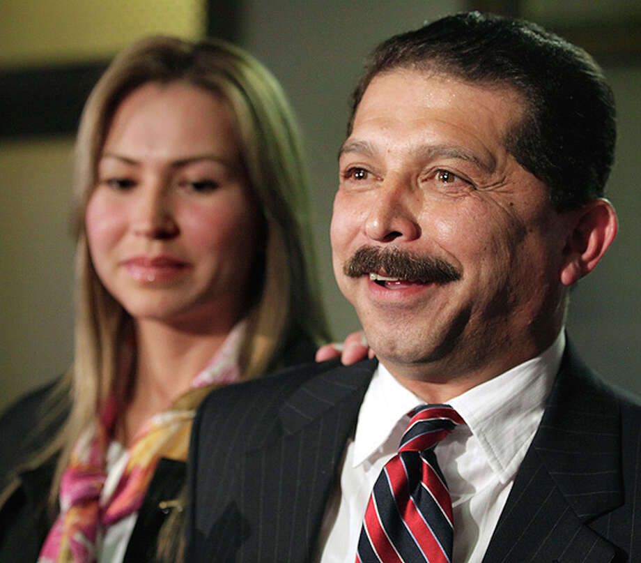 Tejano singer Emilio Navaira, flanked by his wife, Maria Eugenia Navaira, and defense attorney Larry Goldman, speaks to the media after his trial at the Bexar County Courthouse on Jan. 10.