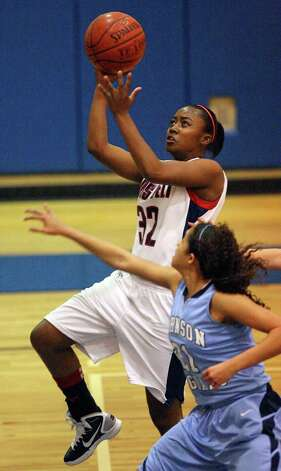 Roosevelt's Shanice Peeples shoots around Johnson's Recee Caldwell during first half action on Monday, Jan. 10, 2011, at Roosevelt High School gymnasium. Roosevelt won 88-65. Photo: EDWARD A. ORNELAS, SAN ANTONIO EXPRESS-NEWS / eaornelas@express-news.net