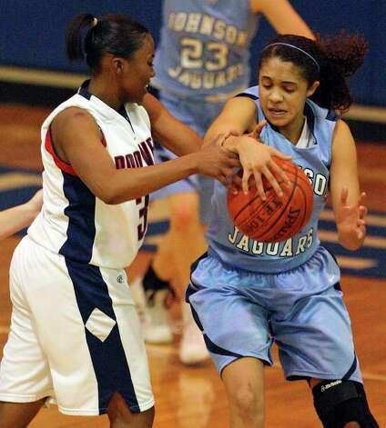 Roosevelt's Shanice Peeples and Johnson's Recee Caldwell struggle for control of the ball during second half action on Monday, Jan. 10, 2011, at Roosevelt High School gymnasium. Roosevelt won 88-65.