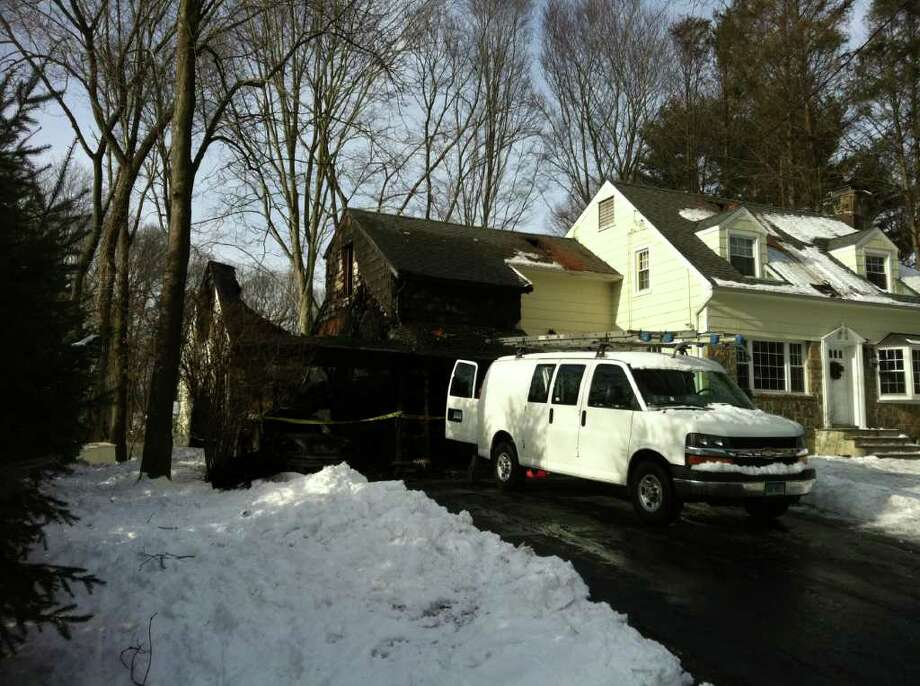 The garage at 13 Wakeman Road in Darien was gutted, along with a 2006 Jaguar and two motorcycles, in a late-night fire on Monday, Jan. 10, 2011. Photo: John Nickerson / Stamford Advocate