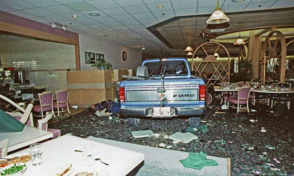 In this photo provided by Ron Franscell and The Department of Public Safety After driving his truck, shown here, through a Luby's Cafeteria in Killeen in 1991, George Hennard shot and killed 23 people and wounded 20 others.