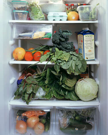 "Photo of a midwife's refrigerator for Mark Menjivar's ""You Are What You Eat"" exhibit."