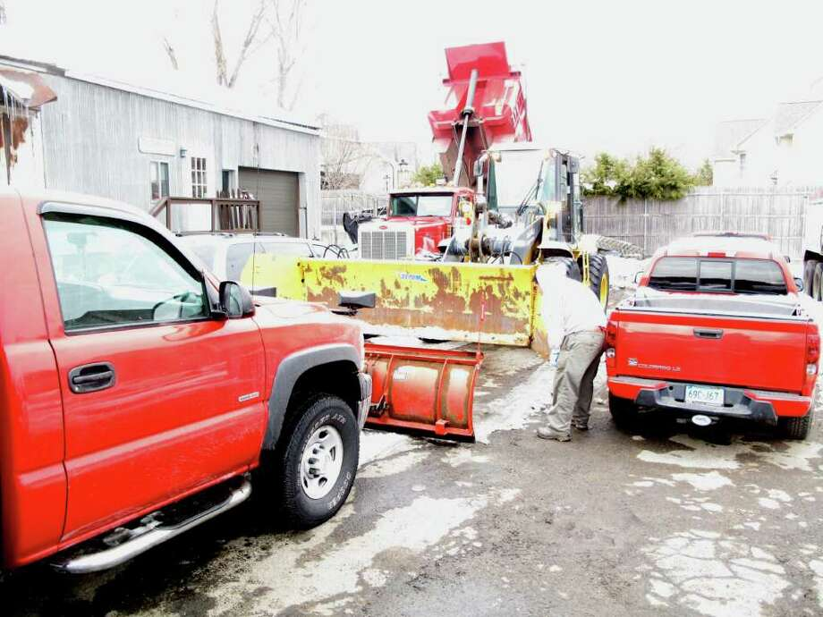 Workers make sure their trucks and plows are ready for another big night of snow. Photo: Contributed Photo;Paresh Jha Contributed Photo, Contributed Photo / New Canaan News