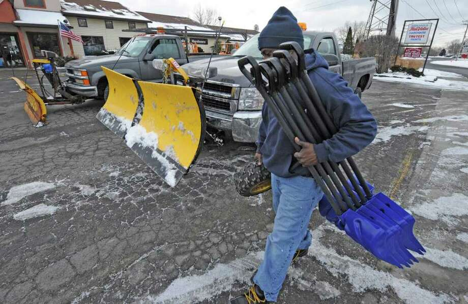 Robert James of Dawn Homes Management of Albany leaves the Menands Hardware store in Menands with an arm load of snow shovels to replace older shovels that have getting plenty of use since the beginning of snow season.  (Skip Dickstein / Times Union) Photo: SKIP DICKSTEIN