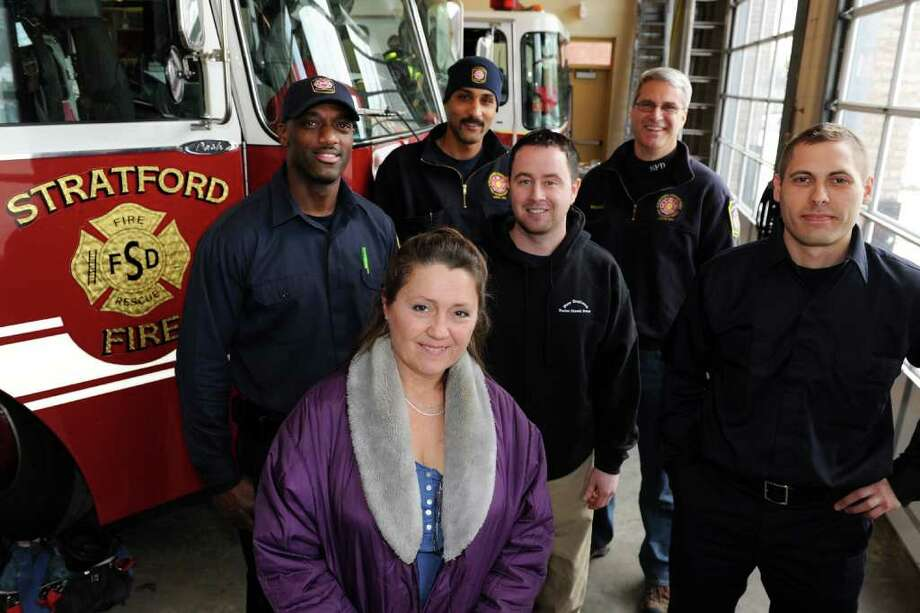 Nansey (cq) Asaro poses with Stratford firefighters (from left) Mike Sweet, Greg Anderson, Jim Flannery, Jim Mecozzi and Tim Becker at fire headquarters in Stratford, Conn. Jan. 11th, 2011. Asaro, who is from East Greenville, Pa. was the driver of a truck that collided with two Stratford fire trucks on I-95 during last Friday's snowstorm. Both fire trucks were totalled in the accident, but none of the firefighters were seriously injured. Photo: Ned Gerard / Connecticut Post